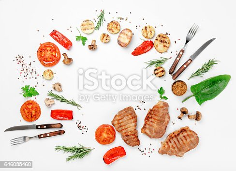 istock Frame of different food grilled on a white background 646085460