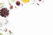 istock Frame of dry flowers on white background. 1202773781