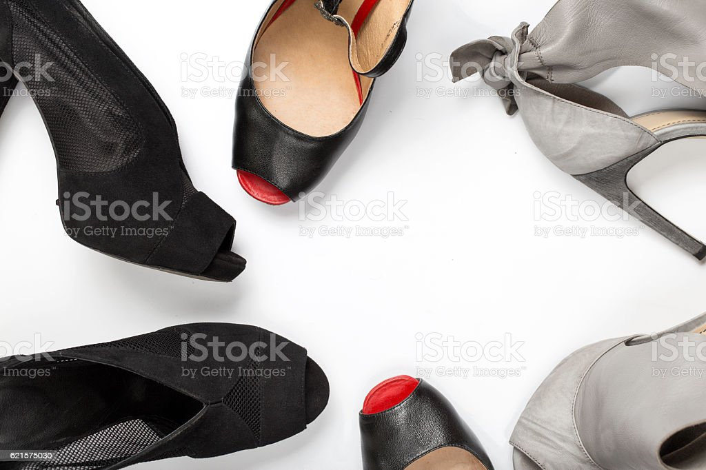 Frame of female shoes on white background photo libre de droits