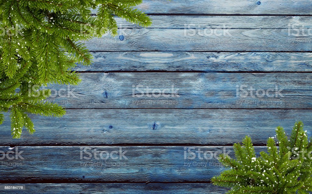 frame of fir branches and snowflakes stock photo