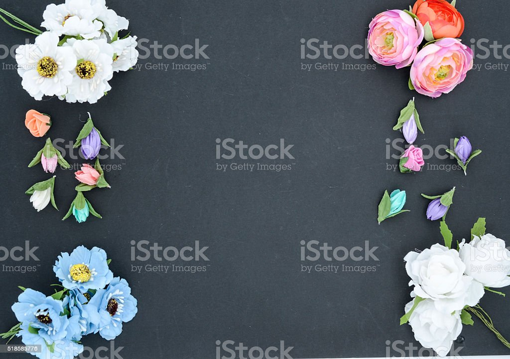 frame of flowers on black stock photo