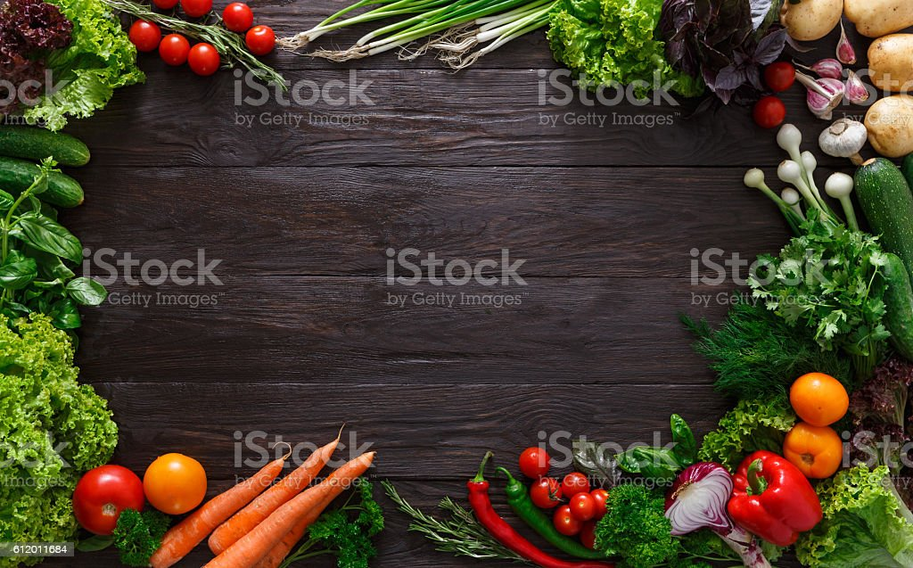 Frame of fresh vegetables on wooden background with copy space stock photo