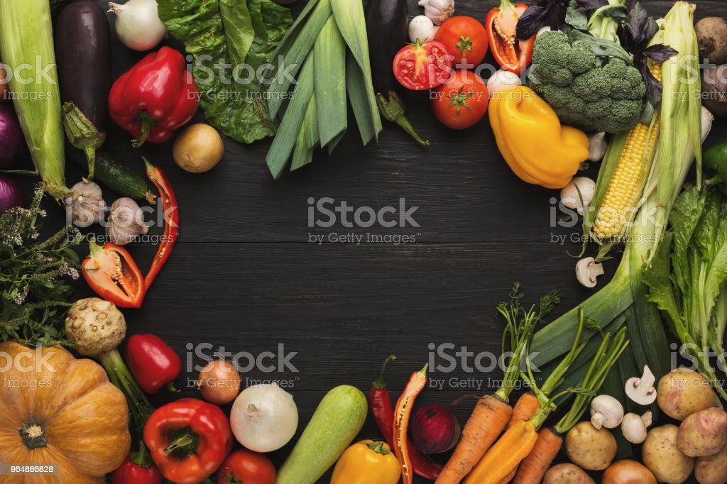 Frame of fresh vegetables on wooden background with copy space royalty-free stock photo