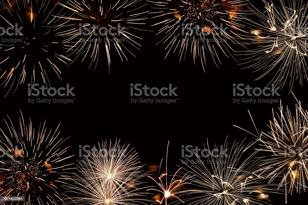 Frame of golden fireworks, black night background stock photo
