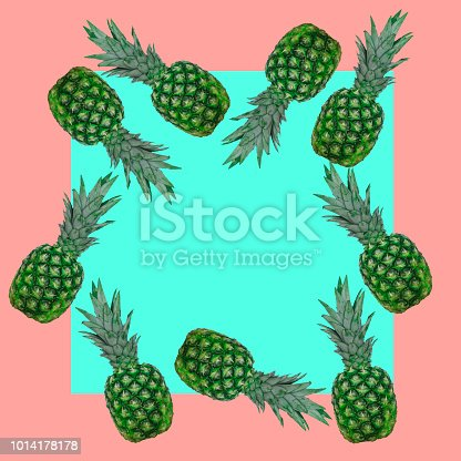 964258970 istock photo Frame of green pineapples on a pink and turquoise background. 1014178178