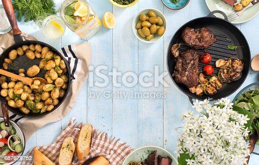 685404620 istock photo Frame of grilled steak, vegetables, potatoes, salad, snacks, homemade lemonade 687679752
