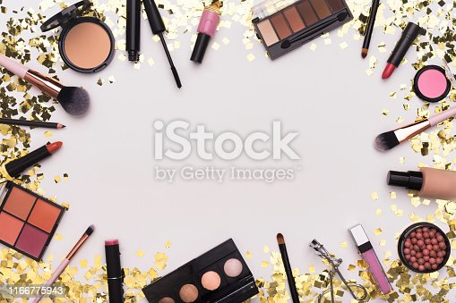 Sparkling cosmetic. Frame of Makeup accessories, essentials and tools on white background with copy space