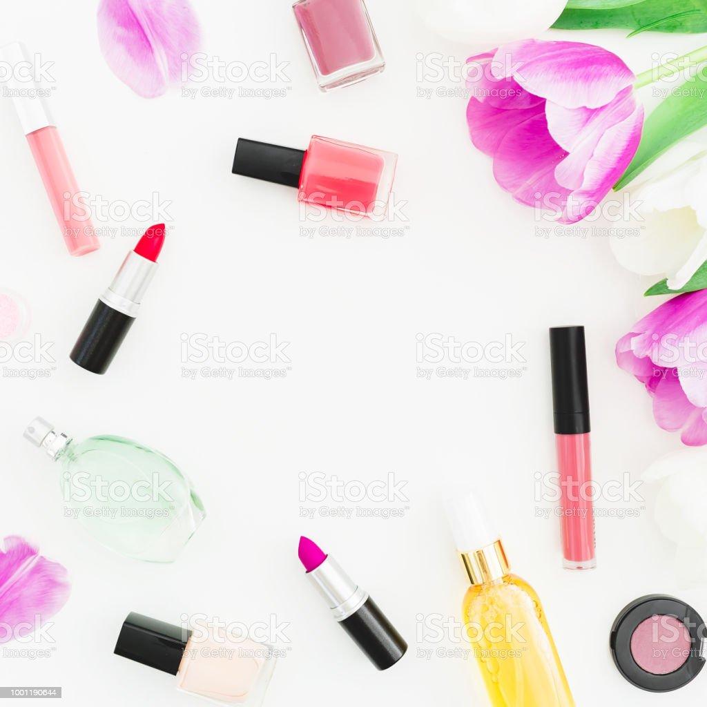Frame of pink flowers and cosmetics lipstick nail polish on white frame of pink flowers and cosmetics lipstick nail polish on white background top izmirmasajfo