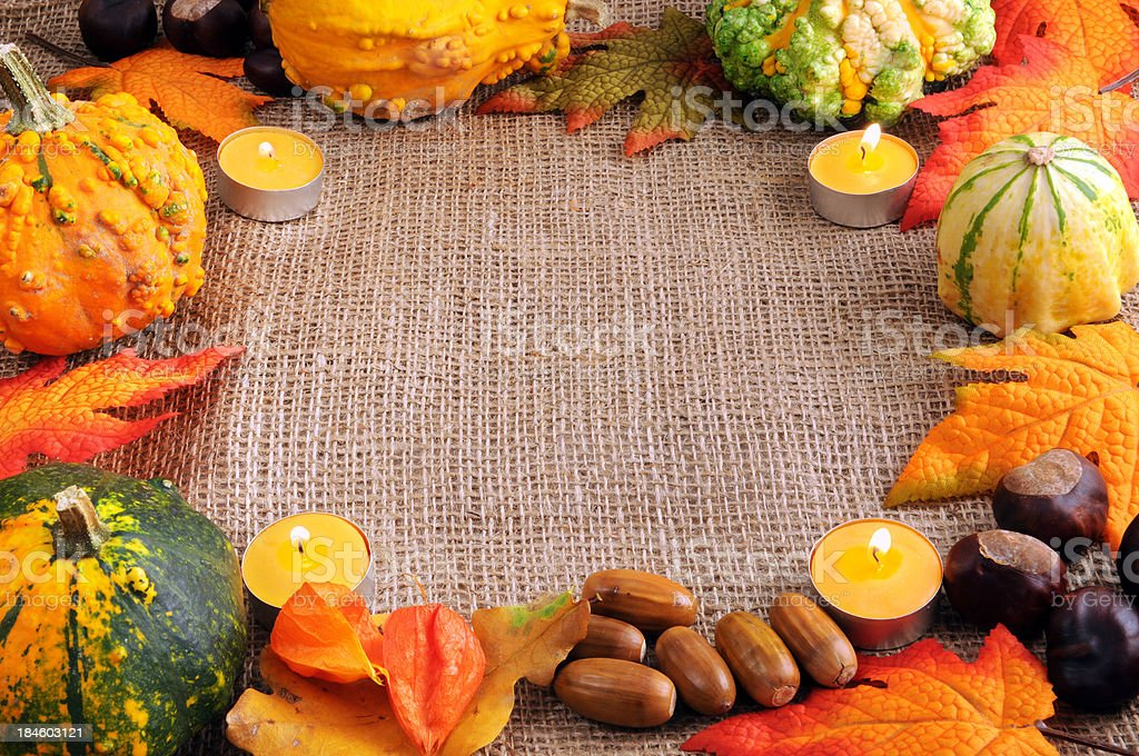 frame of pumpkins acron leaf tea light and copy space royalty-free stock photo