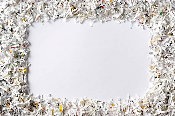 frame of the shredded paper on white background - shredded paper stock photos and pictures