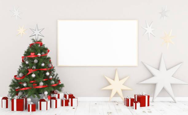 rahmen an einer wand mit weihnachten - strickmantel stock-fotos und bilder