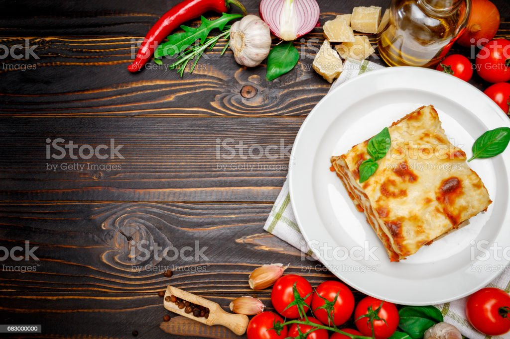 frame - tasty lasagna on wooden backgound royalty-free stock photo