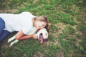 istock Frame with a beautiful girl with a beautiful dog in a park on green grass. 1127316184