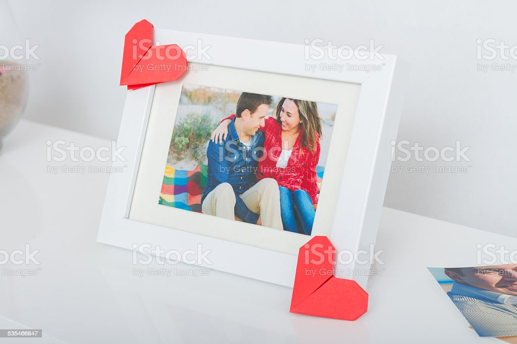 Frame With Couple Photo And Origami Hearts Stock Photo & More ...