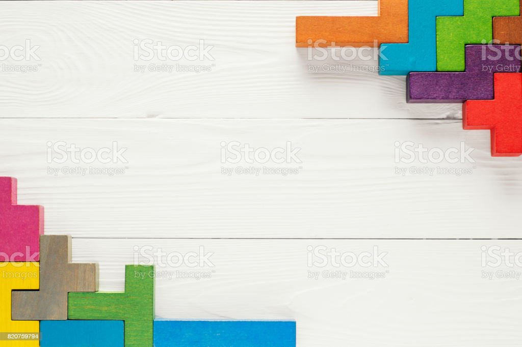 Frame with different colorful shapes wooden blocks stock photo