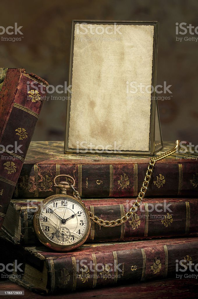 Frame with old photo paper texture, pocket watch and books stock photo