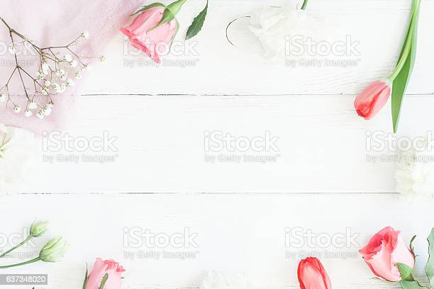Frame with rose flowers and tulip om wooden white background picture id637348020?b=1&k=6&m=637348020&s=612x612&h=5wrmlhzrdnugp huojn99 78tkxgahqsb4yiflfl53k=