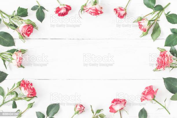 Frame with rose flowers on wooden white background flat lay picture id638404150?b=1&k=6&m=638404150&s=612x612&h= ee jlsiom3mbbbtjswcef4bi9noyvphzsamqv2fpcw=