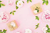 istock Frame with roses and gift box on pastel pink background. Flat lay, top view. Valentines day 1081412124