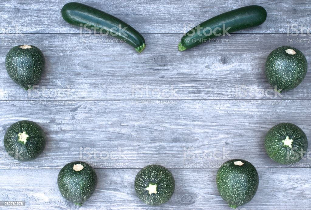 Frame with vegetables on a wooden background and copy space. royalty-free stock photo