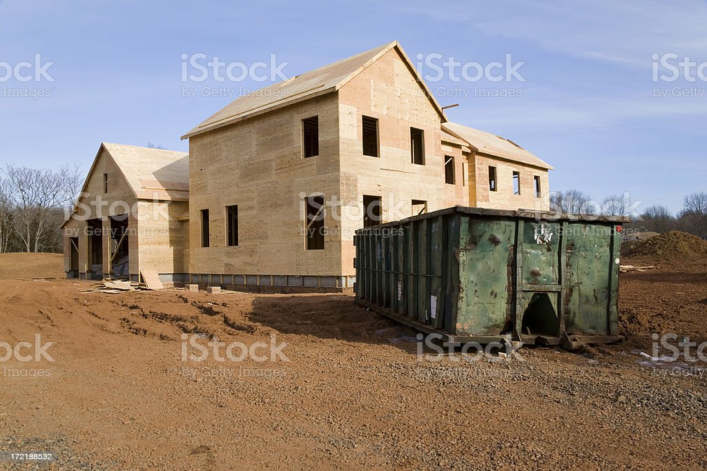 Framed House and Dumpster stock photo