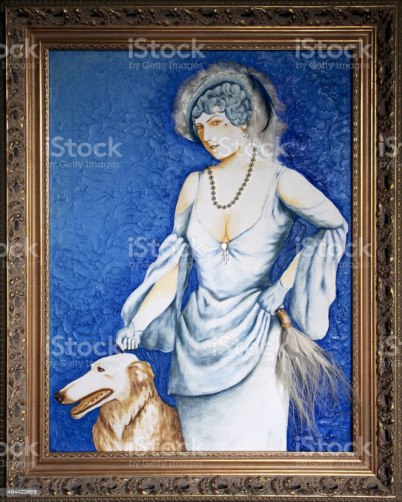 Framed painting of high class woman with greyhound windhound dog stock photo