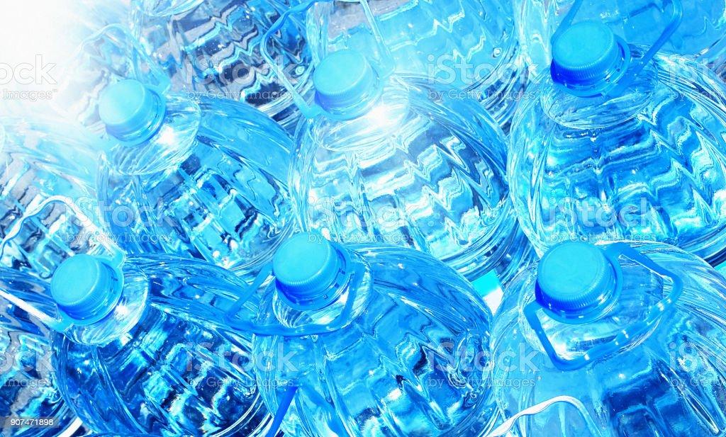 Frame-filling group of blue plastic bottles of water stock photo