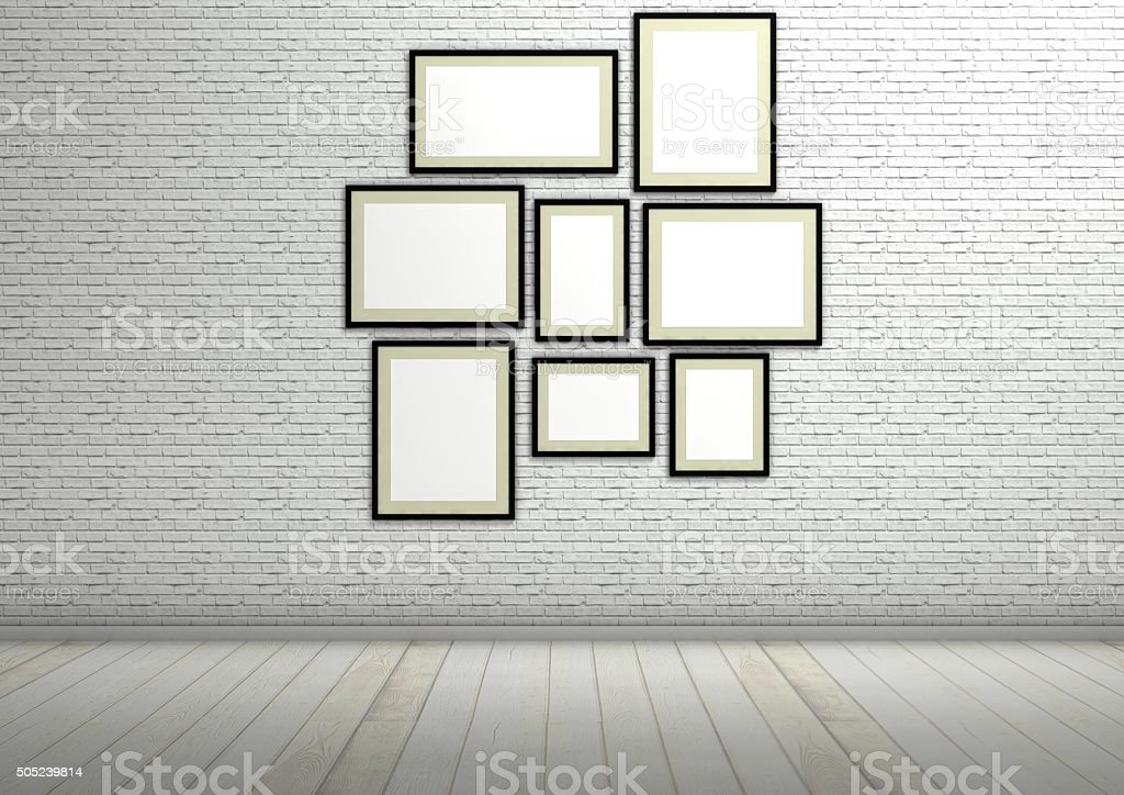 Frames composition on white brick wall, architectural interior stock photo