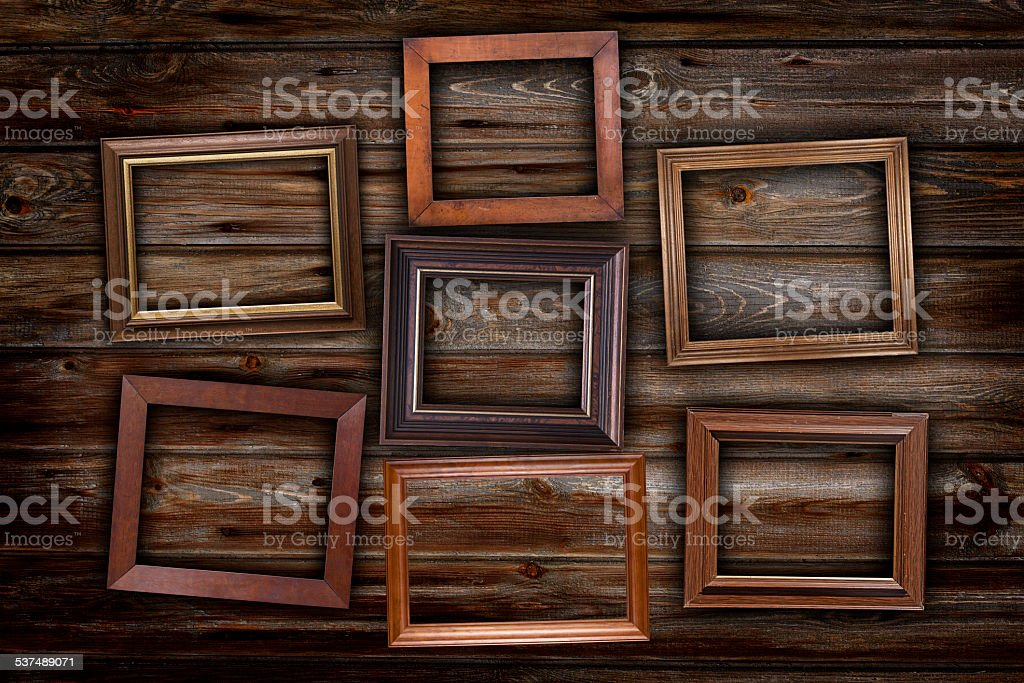Frames on wooden planks stock photo