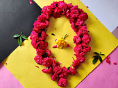 istock Framework from roses. One yellow rose surrounded by pink roses. 1277165726