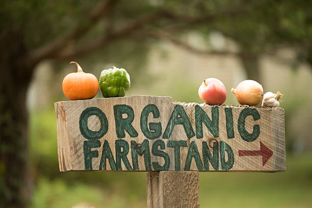 framstand sign - organic farm stock photos and pictures