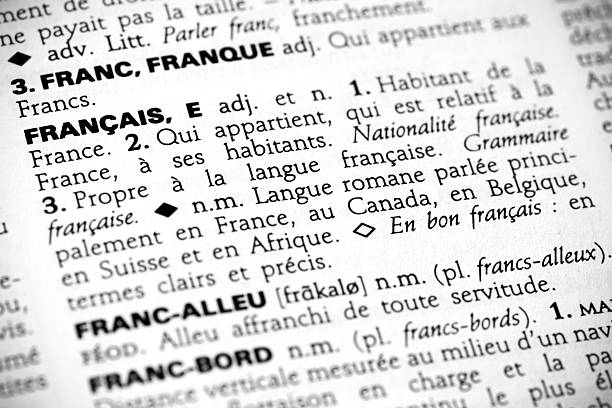 Français in the dictionary Macro shot with focus on the word français and its definition in a french dictionary. french culture stock pictures, royalty-free photos & images