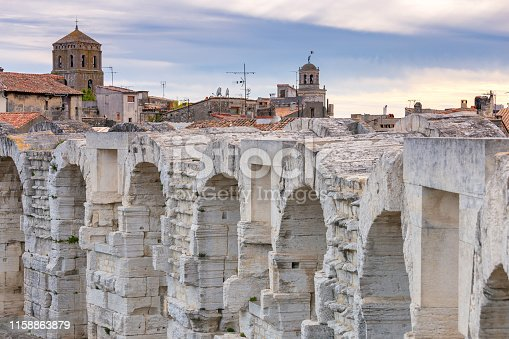View of the old antique arena of the Roman amphitheater in the sunset. Provence. France. Arles.