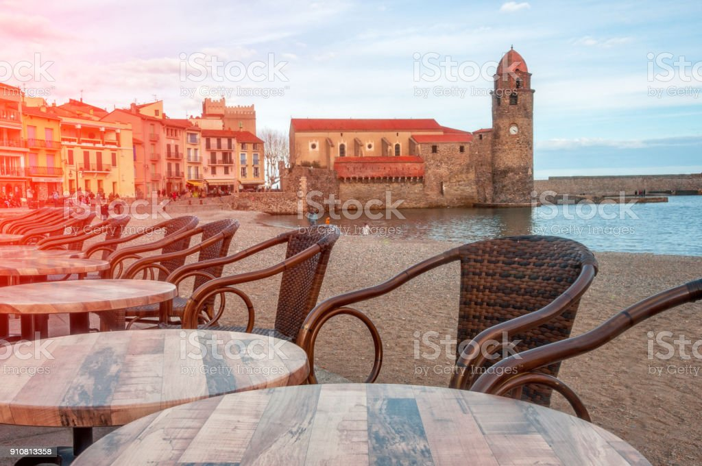 France, Collioure. Coastal cafes with a beautiful view of the sea, the royal palace and the church  Notre Dame des Anges in Collioure, french regions Languedoc-Roussillon. stock photo