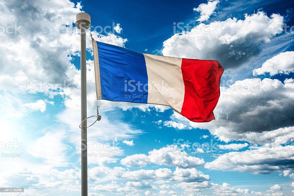France flag on blue sky stock photo