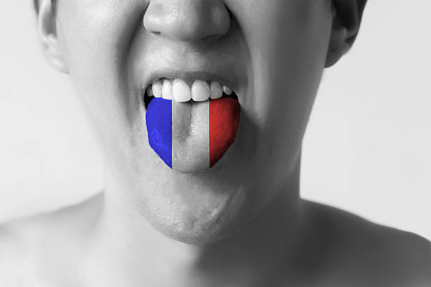 France flag painted in tongue of a man - French - foto de acervo
