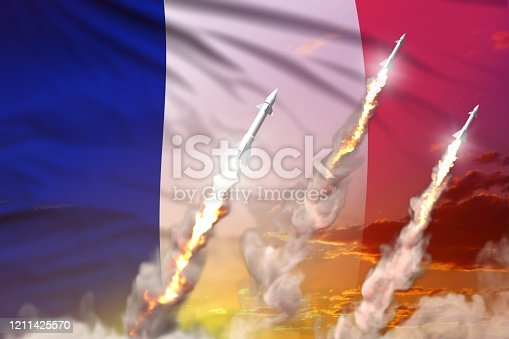 istock France supersonic warhead launch - modern strategic nuclear rocket weapons concept on sunset background, military industrial 3D illustration with flag 1211425570