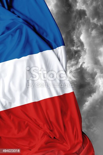 800485914istockphoto France waving flag on bad day 494023318
