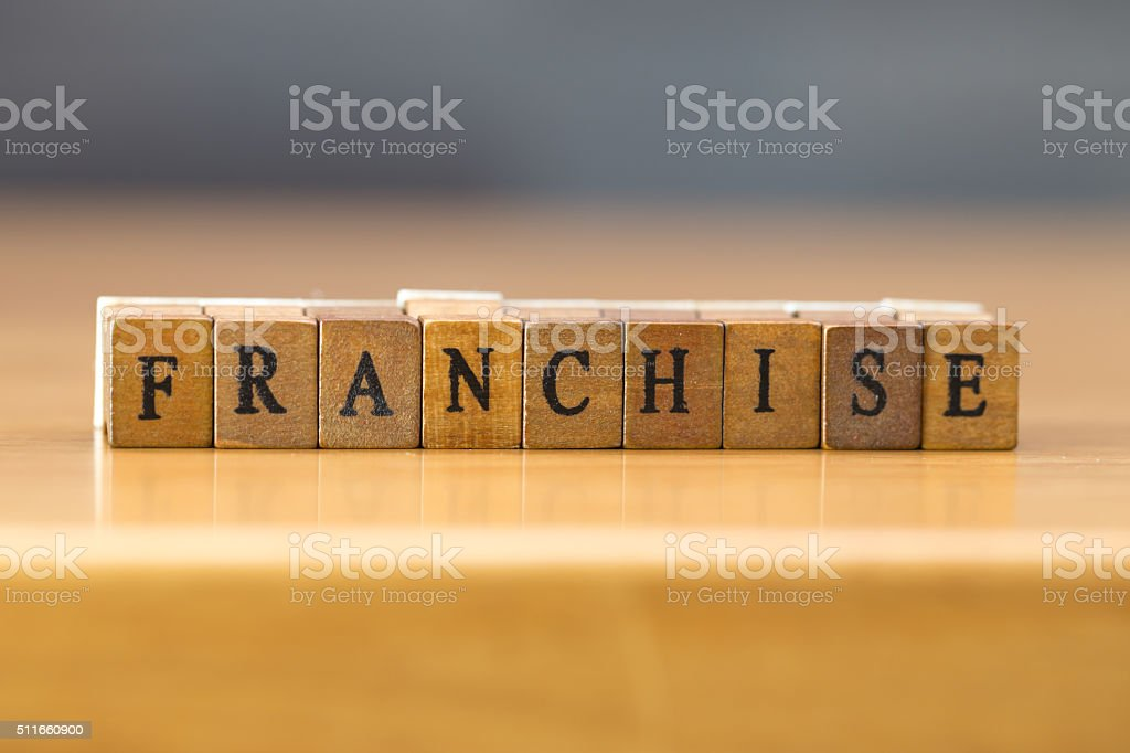 Franchise. word written on wood block stock photo