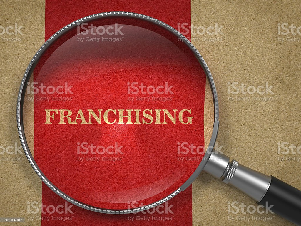Franchising Concept - Magnifying Glass. stock photo