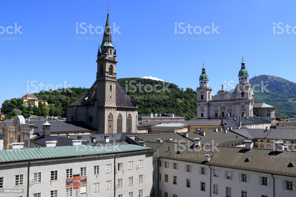 Franciscan Church and the Cathedral of Saints Rupert and Vergilius (Salzburger Dom) in Salzburg, Austria stock photo