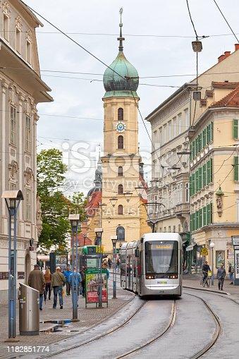 Graz, Austria - May 28 2019: Tramway coming from the Franciscan Church (Austrian: Franziskanerkirche Graz) in the city center.