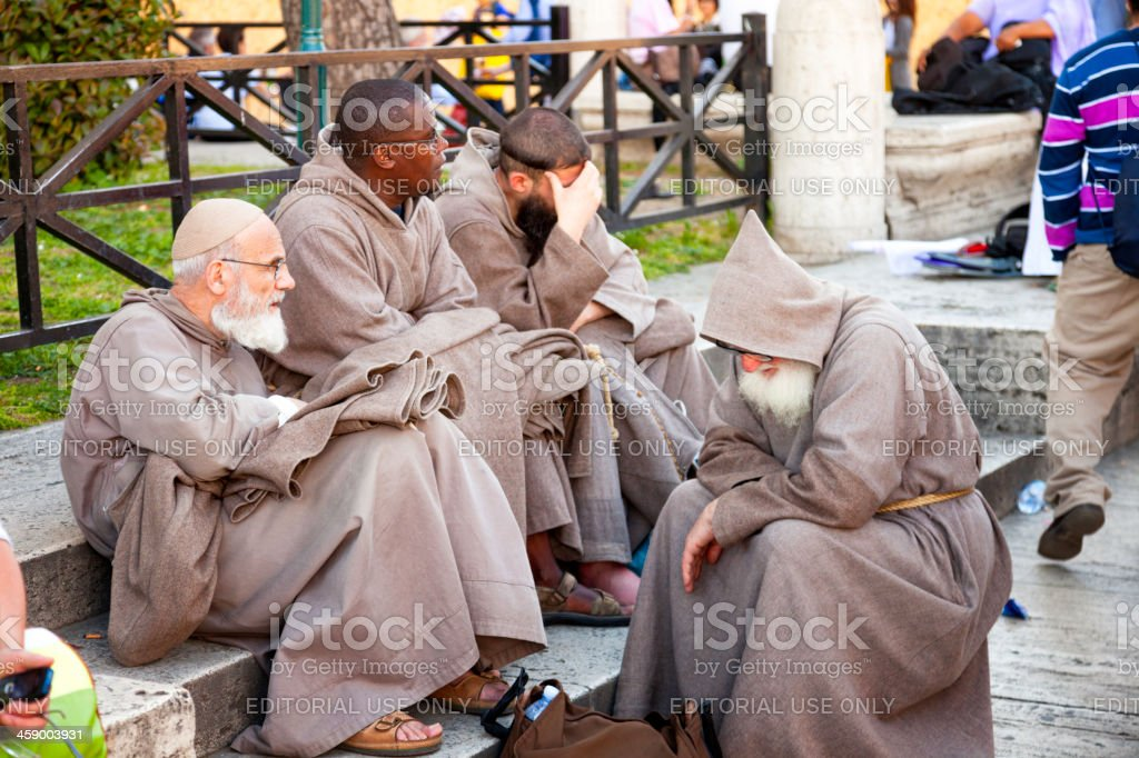 Franciscan friars resting on street during beatification Jean Paul II stock photo