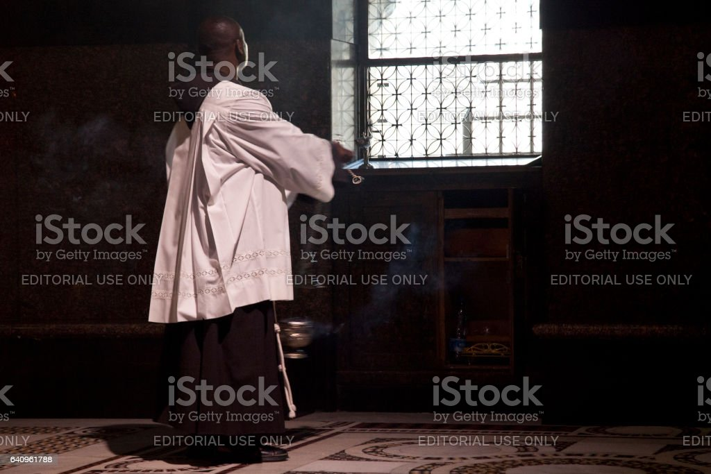 Franciscan monk in Holy Sepulchre stock photo