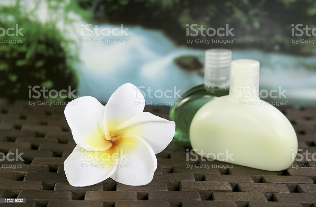 frangipani and oils with waterfall - Royalty-free Alternative Therapy Stock Photo