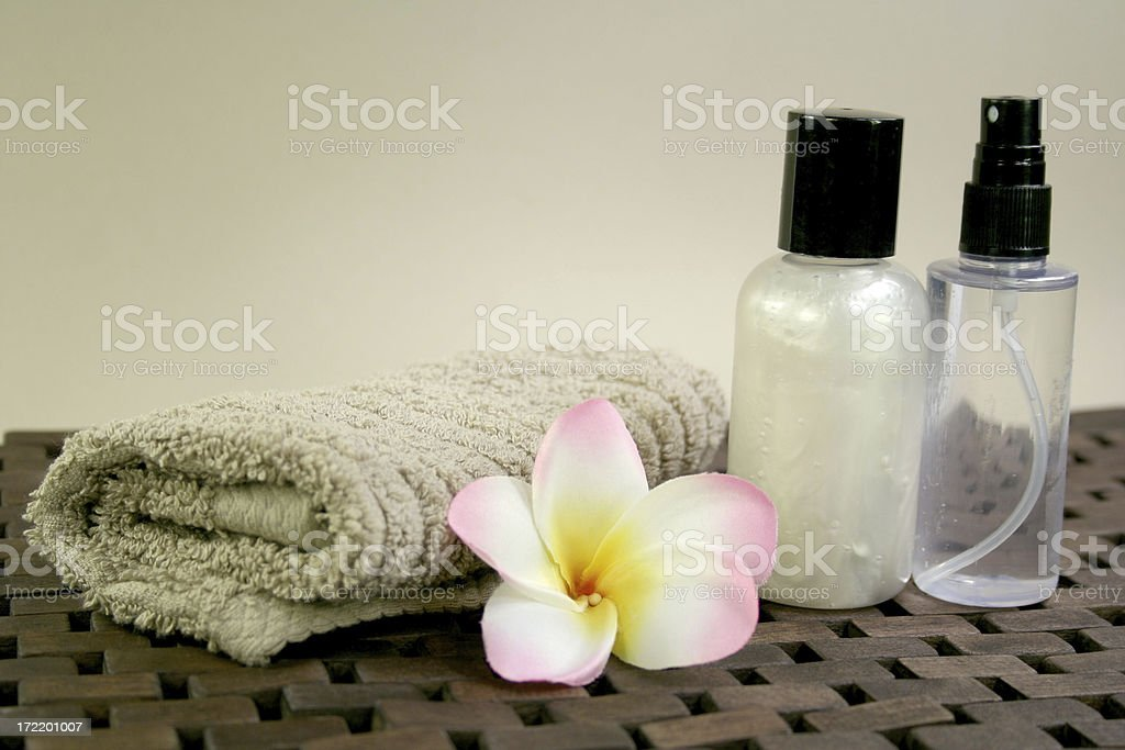 frangipanis, towel and spa products royalty-free stock photo