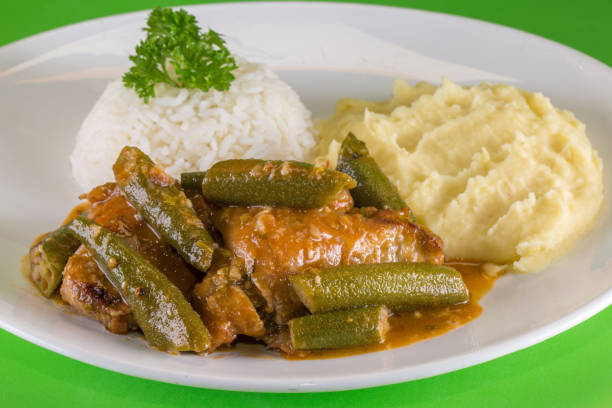 Frango com quiabo. Brazilian food. A chicken meal with okra served with rice and mashed potatoes. Frango com quiabo. Brazilian food. A chicken meal with okra served with rice and mashed potatoes. estudio stock pictures, royalty-free photos & images