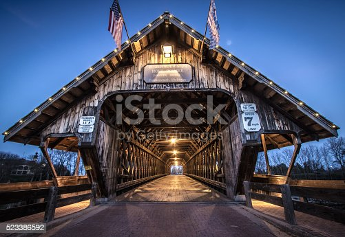 Covered bridge in the town of Frankemuth, Michigan. The local landmark spans the Cass River in the tourist town of Frankenmuth. The bridge is open to autos and pedestrians year around.