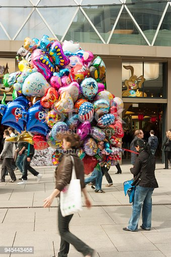 Frankfurt am Main, Germany - March 14, 2018: A woman selling balloons in front of the MyZeil Shopping Mall's facade in center of Frankfurt.