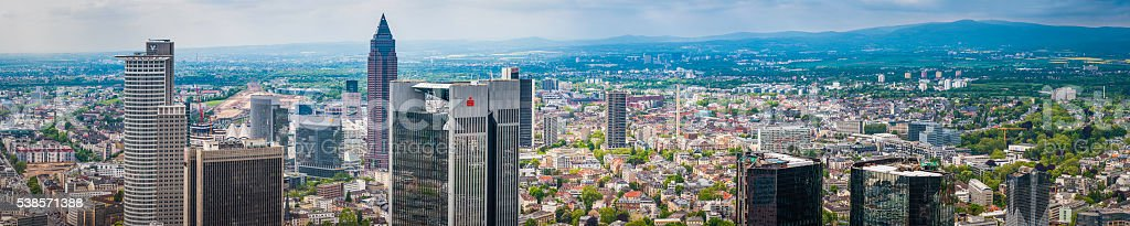 Frankfurt banking district skyscrapers rising over leafy suburbs panorama Germany stock photo